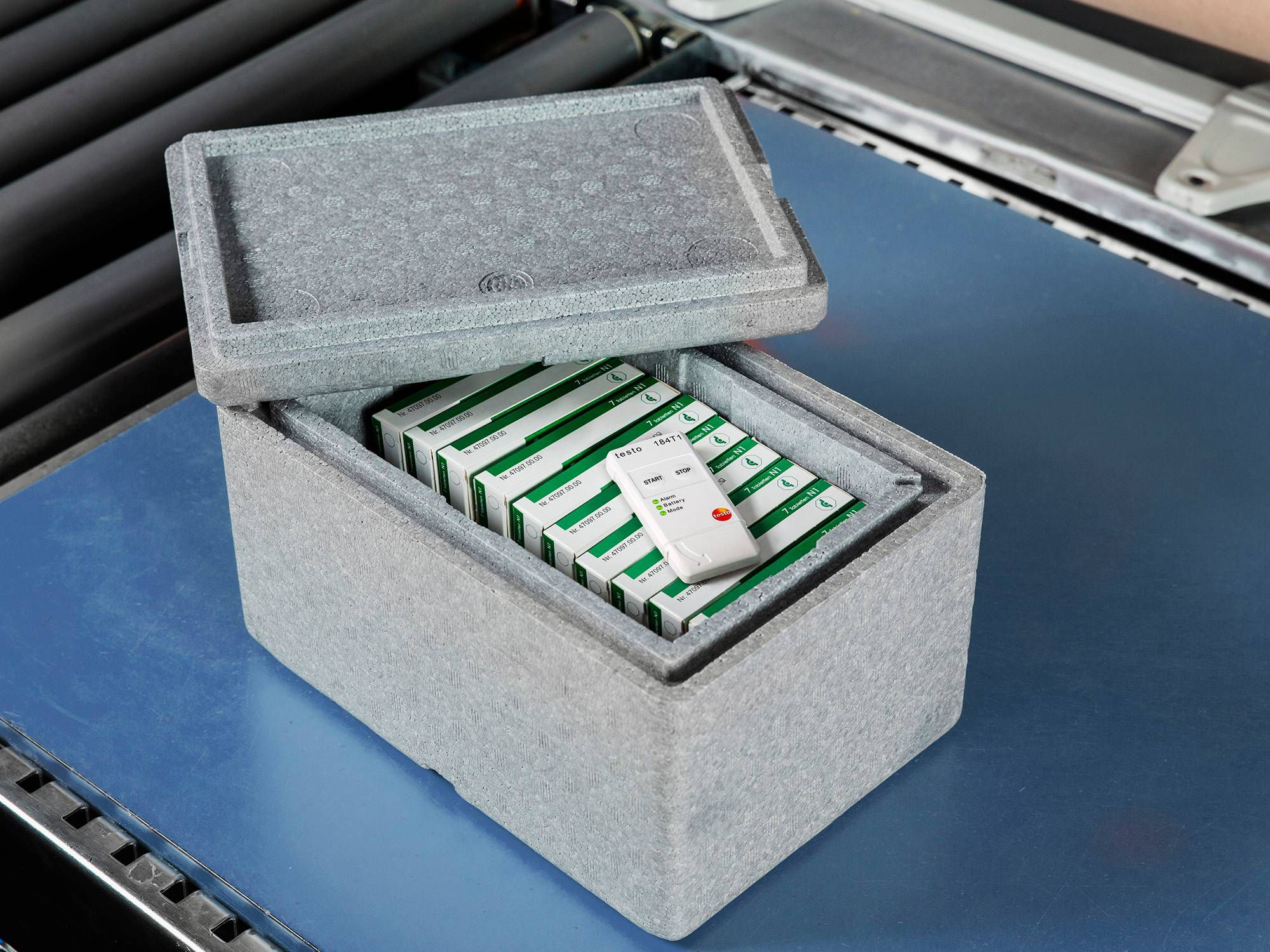 A transport data logger is enclosed with a cool box containing pharmaceuticals