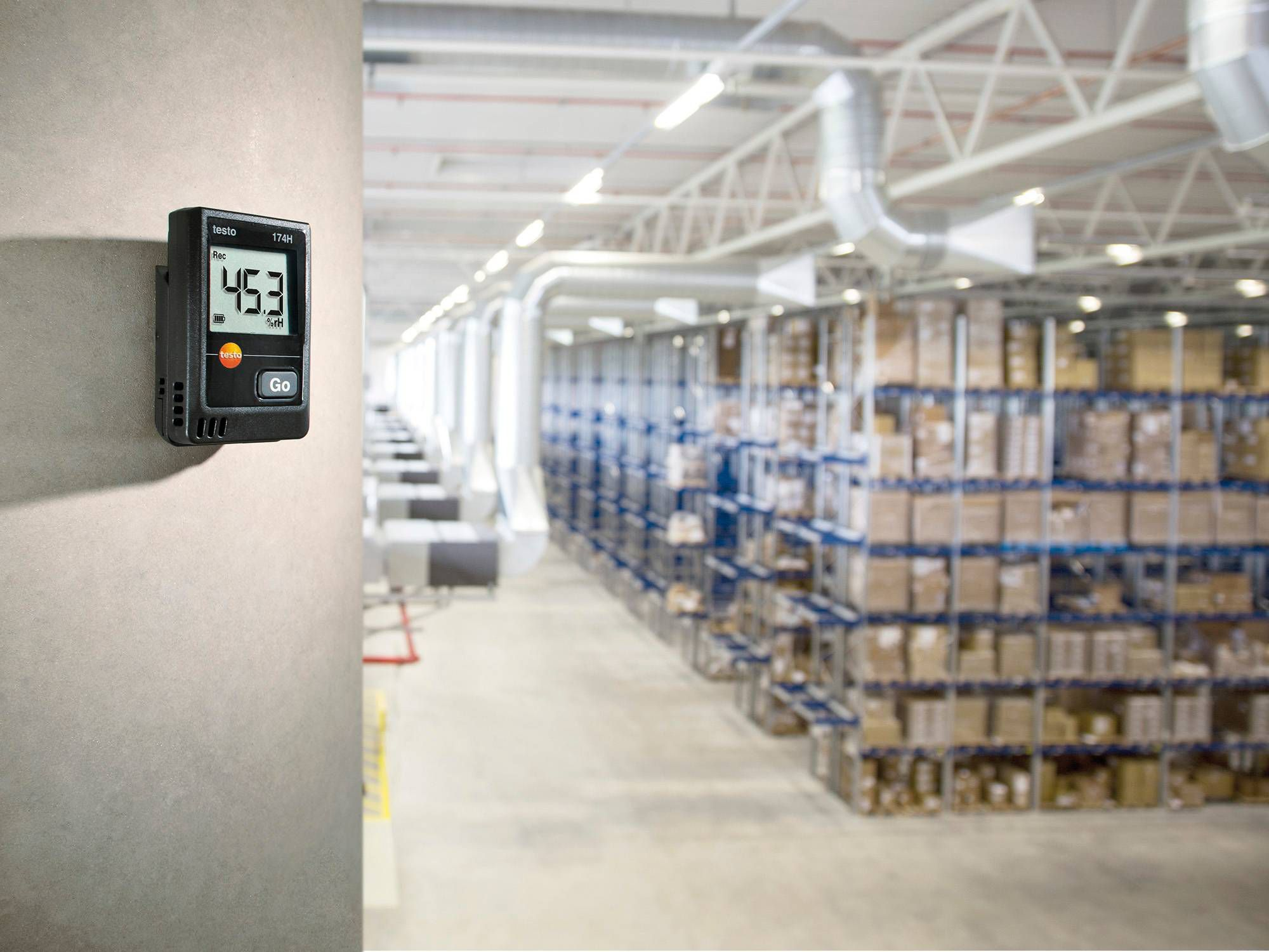 The testo 174 H mini data logger monitors temperature and humidity in a storage room containing pharmaceuticals