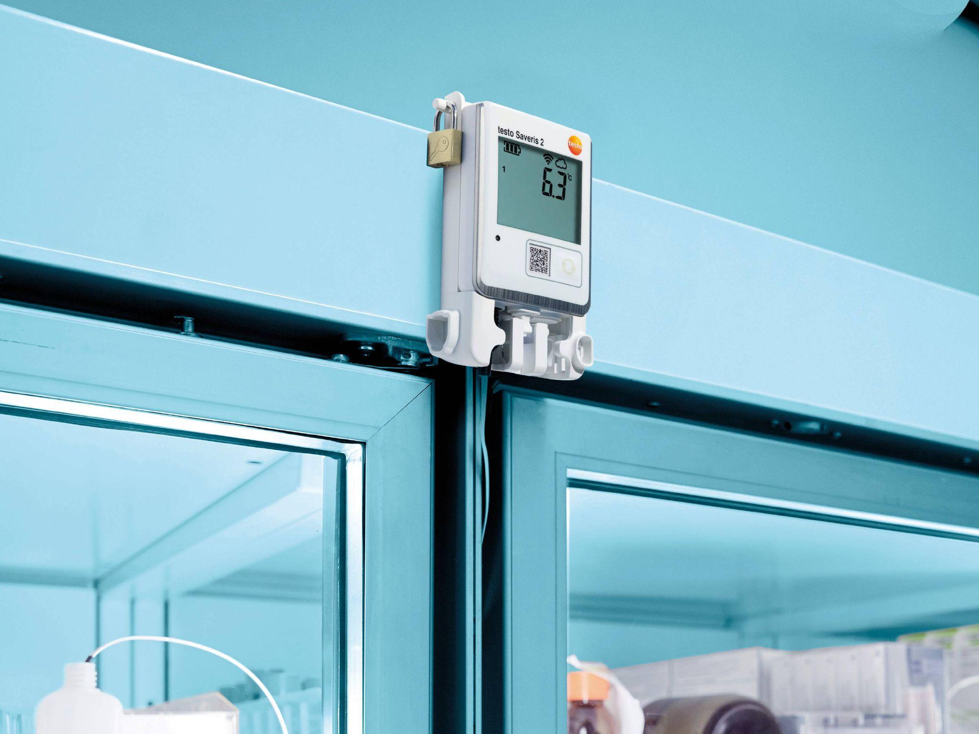 A ribbon cable probe monitors the temperature inside a medicine refrigerator