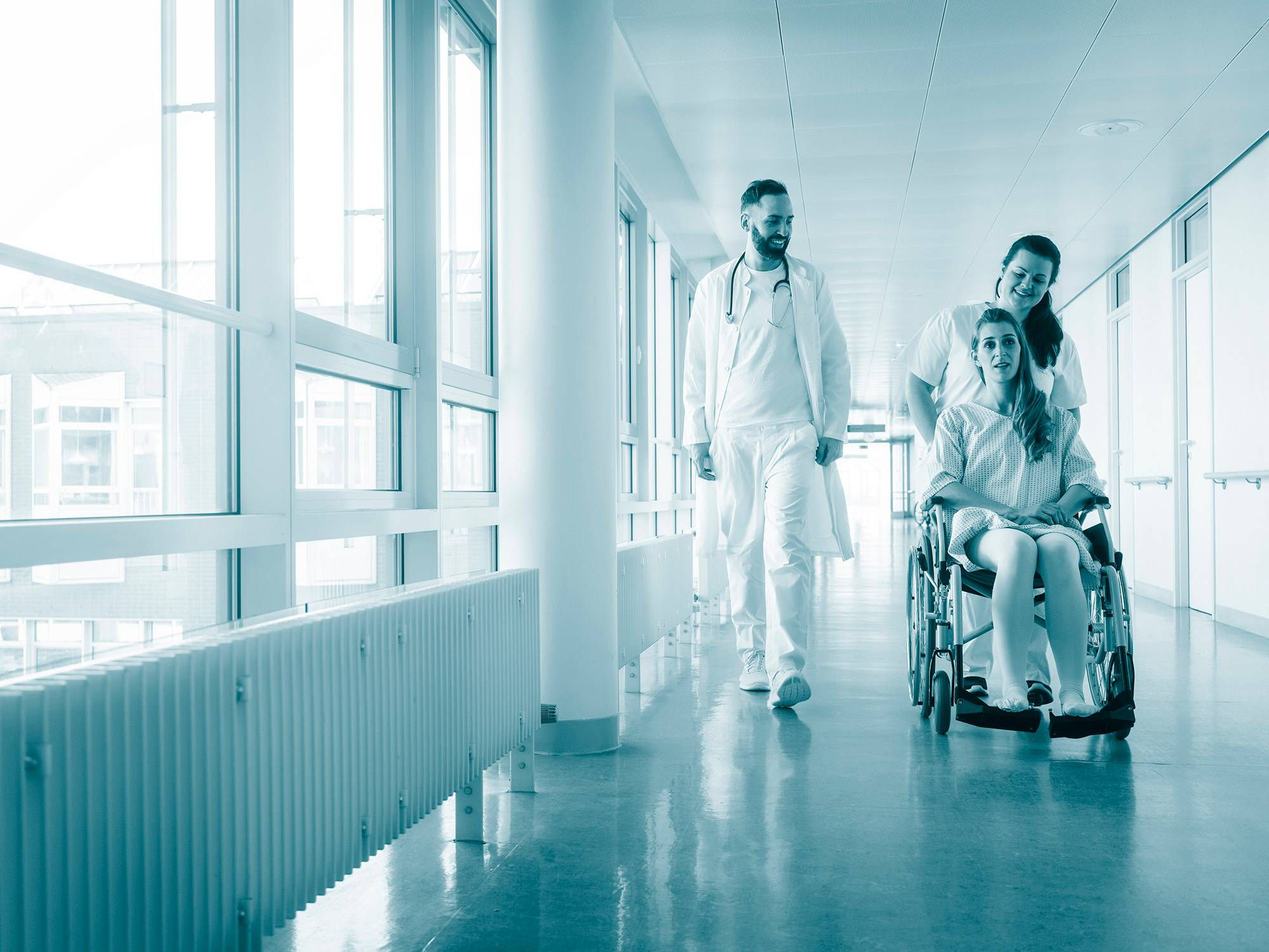 Medical staff caring for a patient in a wheelchair